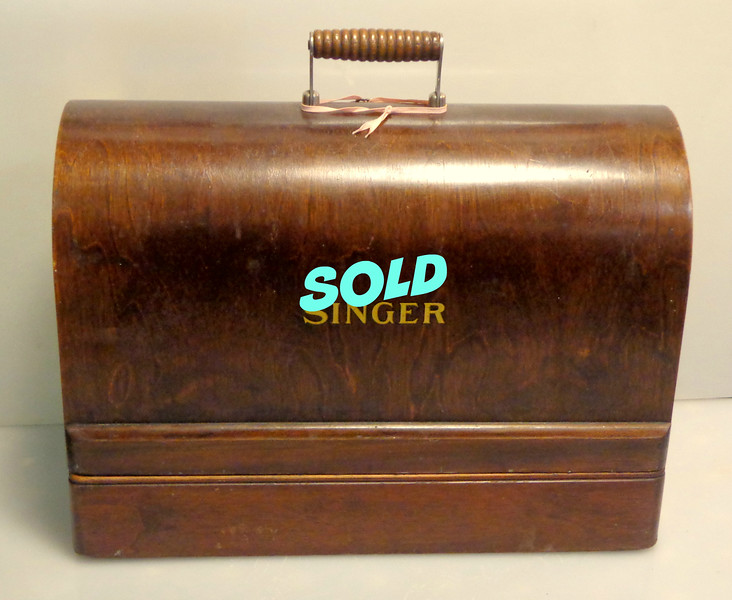 Vintage Transportable Singer Sewing Machine in Excellent Condition.  17 x 9 x 12.  <b>$125</b>