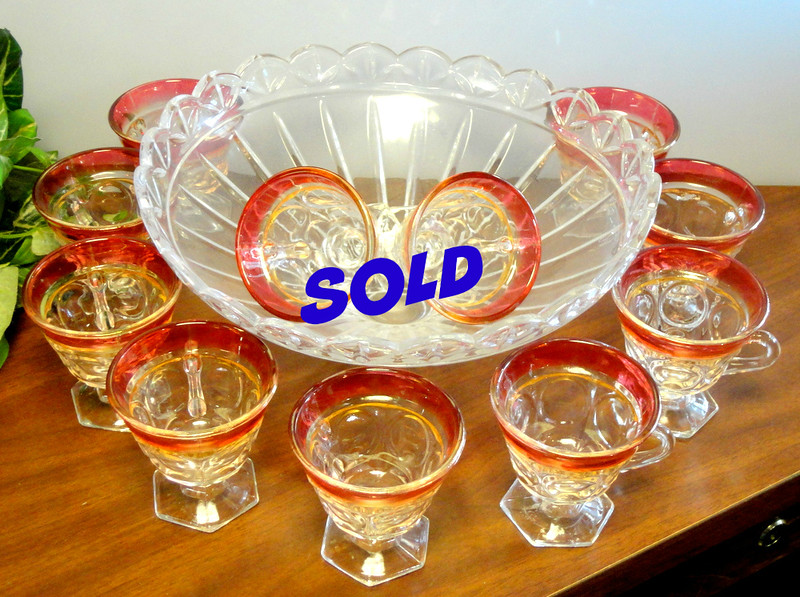 Solid Glass Punch Bowl with 11 Matching Glass Cups.  <b>$75</b>