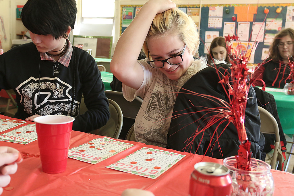 . Students at Goodrich Academy played some bingo after a Christmas diner at the school on Tuesday afternoon. Waiting for her numbers to be called was senior Rachel Cormier, 17 on right. SENTINEL & ENTERPRISE/JOHN LOVE