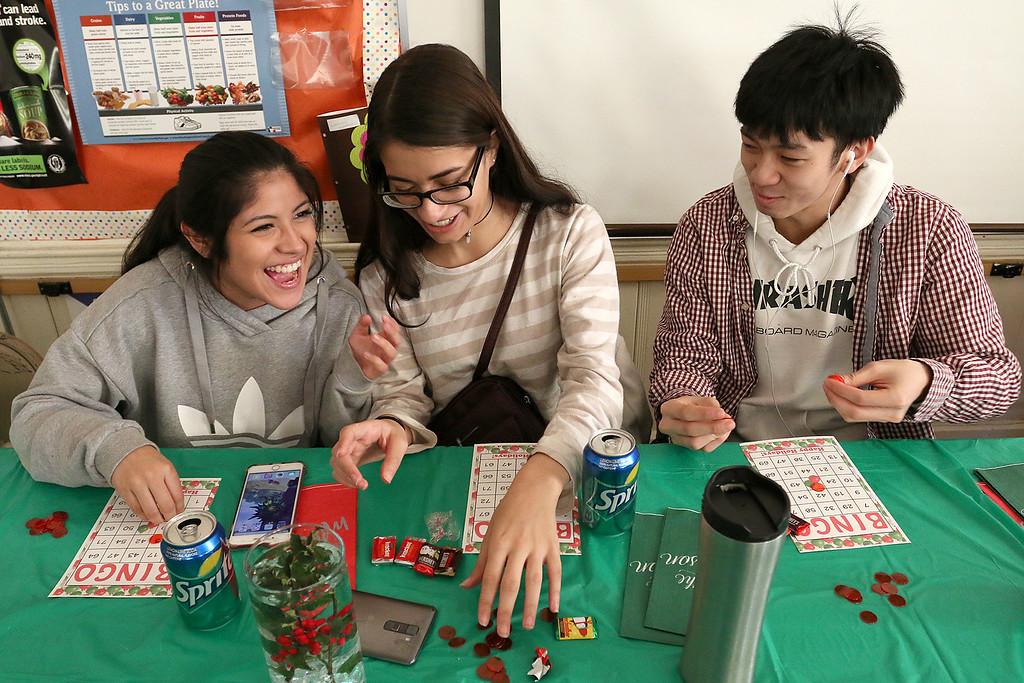 . Students at Goodrich Academy played some bingo after a Christmas diner at the school on Tuesday afternoon. Having a good laugh as they get ready for the game is junior Grace Chapin, 17, junior Aaliyah Franco, 16, and senior Brandon Lepkham, 17. SENTINEL & ENTERPRISE/JOHN LOVE