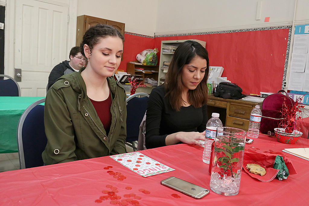 . Students at Goodrich Academy played some bingo after a Christmas diner at the school on Tuesday afternoon. Playing bingo is junior Katrina Stallings and senior Quinones, 18. SENTINEL & ENTERPRISE/JOHN LOVE