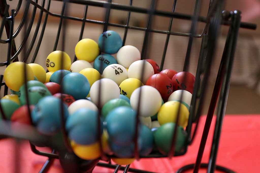 . Students at Goodrich Academy played some bingo after a Christmas diner at the school on Tuesday afternoon. The bingo balls wait inside their cage to be picked. SENTINEL & ENTERPRISE/JOHN LOVE