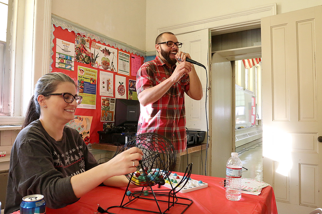 . Students at Goodrich Academy played some bingo after a Christmas diner at the school on Tuesday afternoon. Calling the bingo numbers pulled by English teacher Christina Smith is Career Councilor Anthony Wlison. SENTINEL & ENTERPRISE/JOHN LOVE