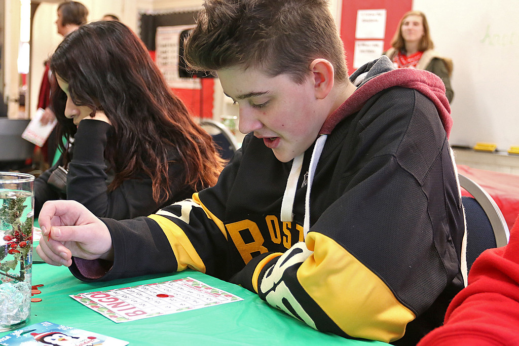. Students at Goodrich Academy played some bingo after a Christmas diner at the school on Tuesday afternoon. waiting for his numbers to be called was junior Zachary Hanks, 16. SENTINEL & ENTERPRISE/JOHN LOVE
