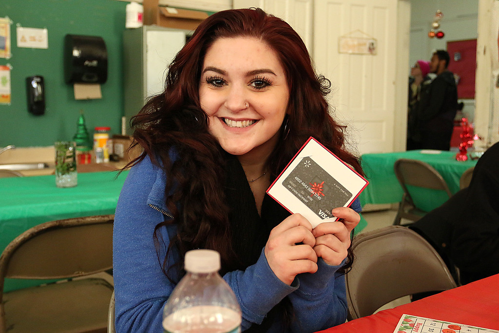 . Students at Goodrich Academy played some bingo after a Christmas diner at the school on Tuesday afternoon. One of the bingo winners was junior Kayleigh Salvi, 16. She won a gift card. SENTINEL & ENTERPRISE/JOHN LOVE