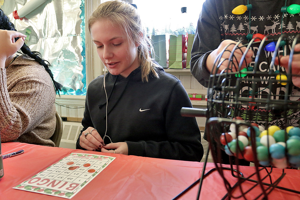 . Students at Goodrich Academy played some bingo after a Christmas diner at the school on Tuesday afternoon. Playing bingo is junior Abby Prentiss, 17. SENTINEL & ENTERPRISE/JOHN LOVE