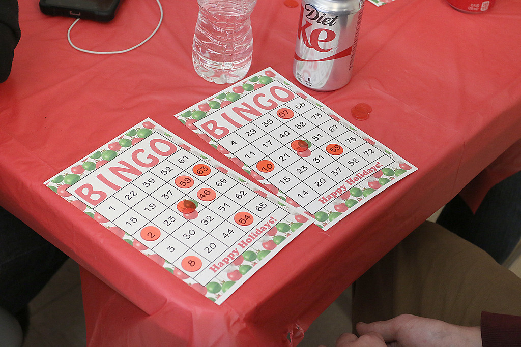 . Students at Goodrich Academy played some bingo after a Christmas diner at the school on Tuesday afternoon. SENTINEL & ENTERPRISE/JOHN LOVE