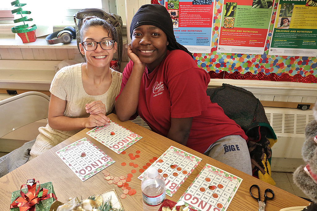 . Students at Goodrich Academy played some bingo after a Christmas diner at the school on Tuesday afternoon. Having fun together during the bing was senior Angely Franco, 18, and senior Na\'Rya George, 19. SENTINEL & ENTERPRISE/JOHN LOVE