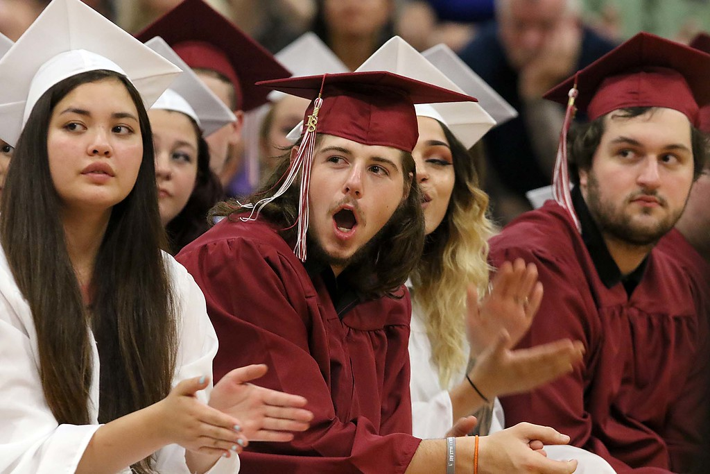 . Scenes from the Goodrich Academy Class of 2018 graduation on Thursday 31, 2018 at the Fitchburg High School field house. Cheering for his fellow graduates is Dakota Blanchard. SENTINEL & ENTERPRISE/JOHN LOVE