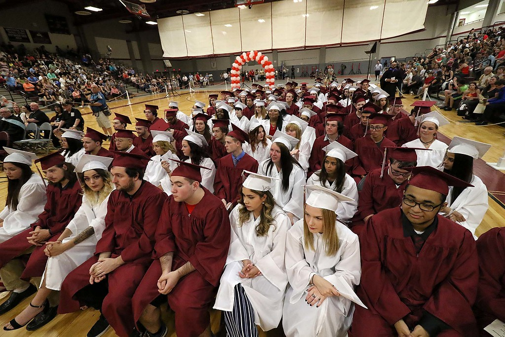 . Scenes from the Goodrich Academy Class of 2018 graduation on Thursday 31, 2018 at the Fitchburg High School field house. Graduates listen to the speakers during the ceremony. SENTINEL & ENTERPRISE/JOHN LOVE