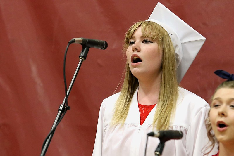 "Scenes from the Goodrich Academy Class of 2018 graduation on Thursday 31, 2018 at the Fitchburg High School field house. Singing ""We are the Champions"" by Queen with the GA chorus is graduate Veronica Dobson. SENTINEL & ENTERPRISE/JOHN LOVE"