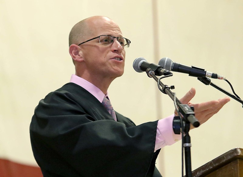 Scenes from the Goodrich Academy Class of 2018 graduation on Thursday 31, 2018 at the Fitchburg High School field house. FHS Principal Jeremy Roche addresses the graduates during the ceremony. SENTINEL & ENTERPRISE/JOHN LOVE