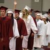 Scenes from the Fitchburg Goodrich Academy graduation at Fitchburg High School on Thursday June 1, 2017. One of the grads waves to her family as they march into the FHS field house at the start of the ceremony. SENTINEL & ENTERPRISE/JOHN LOVE