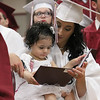 Scenes from the Fitchburg Goodrich Academy graduation at Fitchburg High School on Thursday June 1, 2017. Graduate Ivett Gonsalez shows her diploma to her daughter Mya Estrella, 1, during the ceremony. SENTINEL & ENTERPRISE/JOHN LOVE