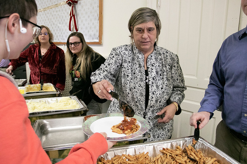 Fitchburg's Goodrich Academy held a holiday party for it students on Wednesday, Dec. 18, 2019. Principal Alexis Curry helped served up some food for the students at the party. SENTINEL & ENTERPRISE/JOHN LOVE