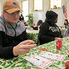 Fitchburg's Goodrich Academy held a holiday party for it students on Wednesday, Dec. 18, 2019. Playing Bingo at the party for some prizes is sophomore Nathan Herbert. SENTINEL & ENTERPRISE/JOHN LOVE