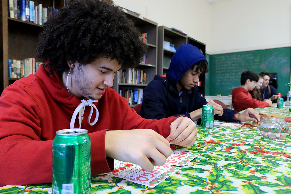 . Goodrich Academy in Fitchburg held a holiday lunch for students on Wednesday afternoon, December 19, 2018. They had six sponsors that helped them so they could put on this event for the students. They were Brandon Funeral Home, Ilforno Restaurant, A&B Tires, Foster Insurance, HML Development and Leo Xarras. Playing bingo and triying to win a prise was Christian Lopez, 17. SENTINEL & ENTERPRISE/JOHN LOVE