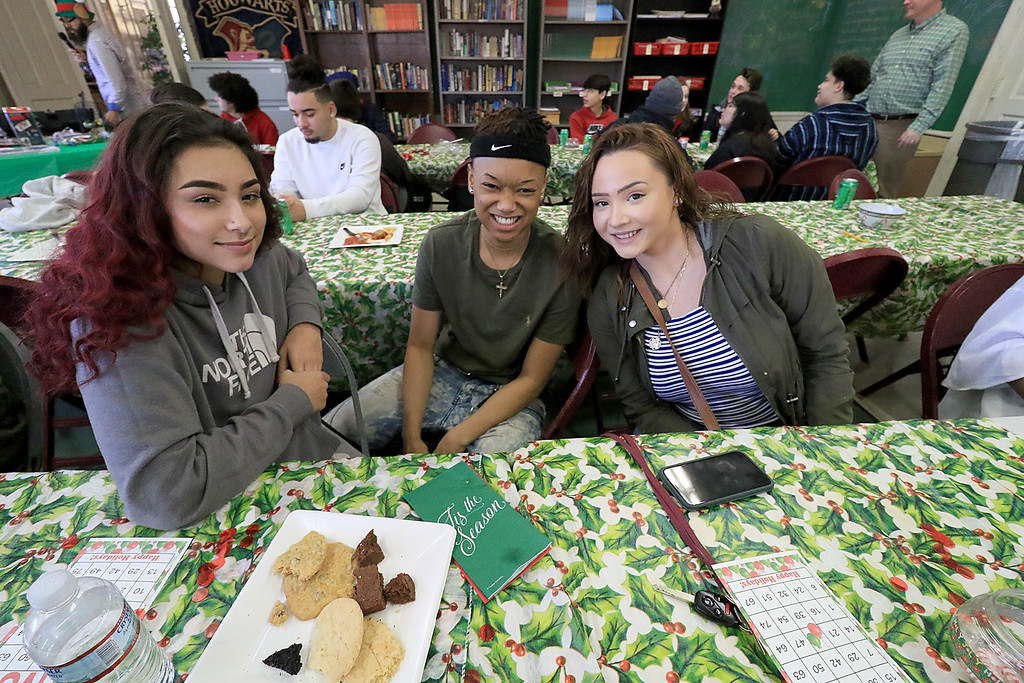 . Goodrich Academy in Fitchburg held a holiday lunch for students on Wednesday afternoon, December 19, 2018. They had six sponsors that helped them so they could put on this event for the students. They were Brandon Funeral Home, Ilforno Restaurant, A&B Tires, Foster Insurance, HML Development and Leo Xarras. Having fun at the luncheon was students, from left, Joseline Solis, 16, Jaeda Stewart, 15, Dezyre Hughes, 17. SENTINEL & ENTERPRISE/JOHN LOVE