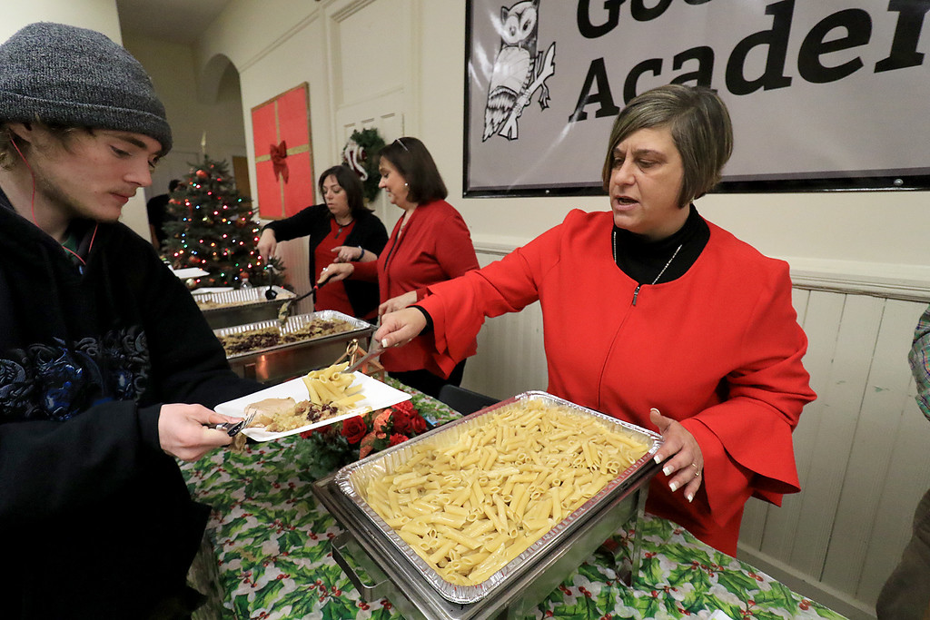 . Goodrich Academy in Fitchburg held a holiday lunch for students on Wednesday afternoon, December 19, 2018. They had six sponsors that helped them so they could put on this event for the students. They were Brandon Funeral Home, Ilforno Restaurant, A&B Tires, Foster Insurance, HML Development and Leo Xarras. Serving up some pasta to student Joseph Pupi, 17, is Principal Alexis Curry. SENTINEL & ENTERPRISE/JOHN LOVE