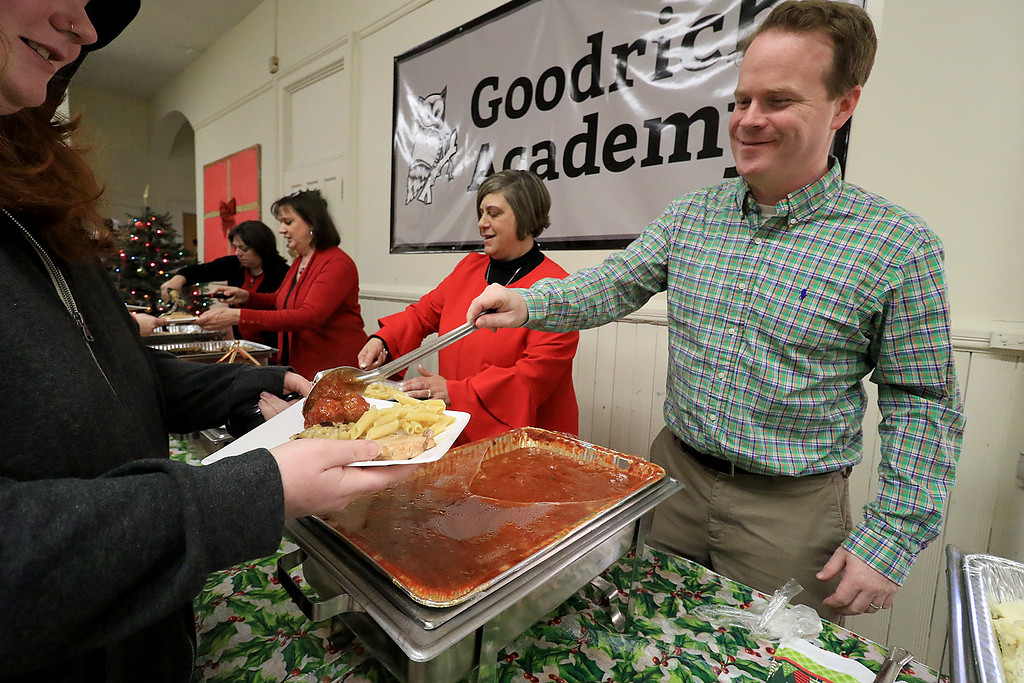 . Goodrich Academy in Fitchburg held a holiday lunch for students on Wednesday afternoon, December 19, 2018. They had six sponsors that helped them so they could put on this event for the students. They were Brandon Funeral Home, Ilforno Restaurant, A&B Tires, Foster Insurance, HML Development and Leo Xarras. Serving up some meatballs for the students is History Teacher Brad McNamara. SENTINEL & ENTERPRISE/JOHN LOVE