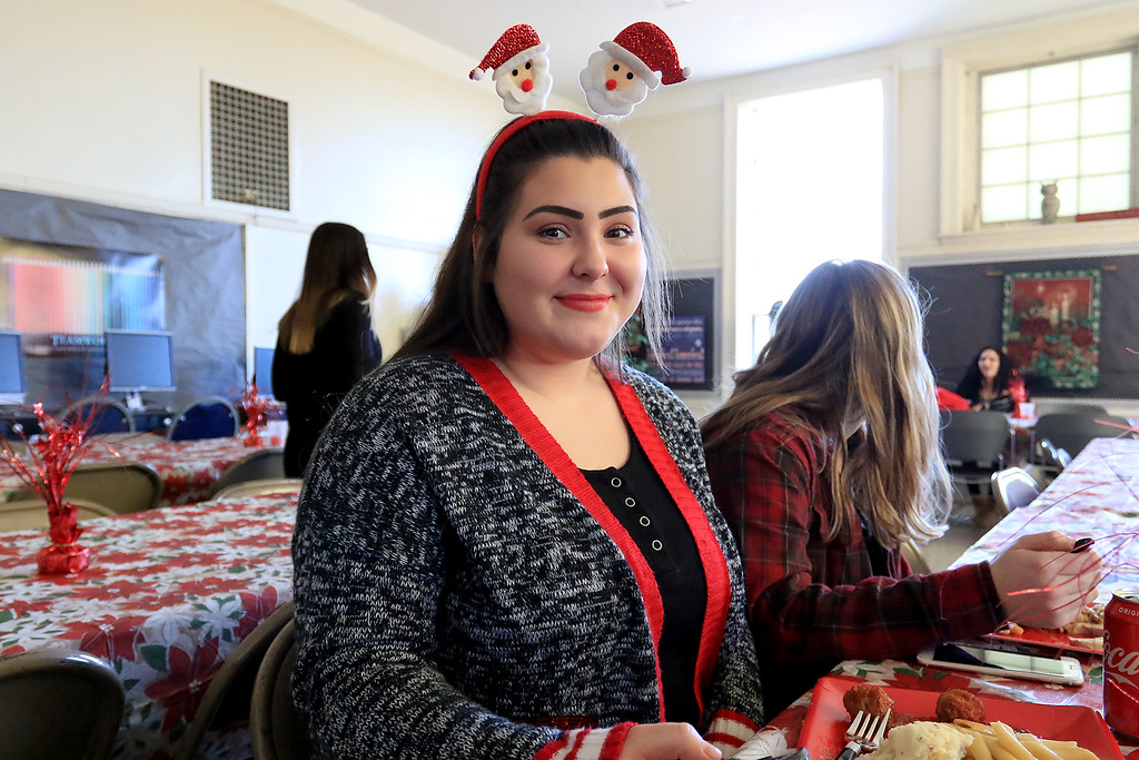 . Goodrich Academy in Fitchburg held a holiday lunch for students on Wednesday afternoon, December 19, 2018. They had six sponsors that helped them so they could put on this event for the students. They were Brandon Funeral Home, Ilforno Restaurant, A&B Tires, Foster Insurance, HML Development and Leo Xarras. Having fun at the luncheon is Tyler Rosseau, 16. SENTINEL & ENTERPRISE/JOHN LOVE