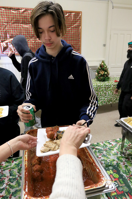 . Goodrich Academy in Fitchburg held a holiday lunch for students on Wednesday afternoon, December 19, 2018. They had six sponsors that helped them so they could put on this event for the students. They were Brandon Funeral Home, Ilforno Restaurant, A&B Tires, Foster Insurance, HML Development and Leo Xarras. Getting some meatballs during the lunch was student Jacob Velasquez, 17. SENTINEL & ENTERPRISE/JOHN LOVE