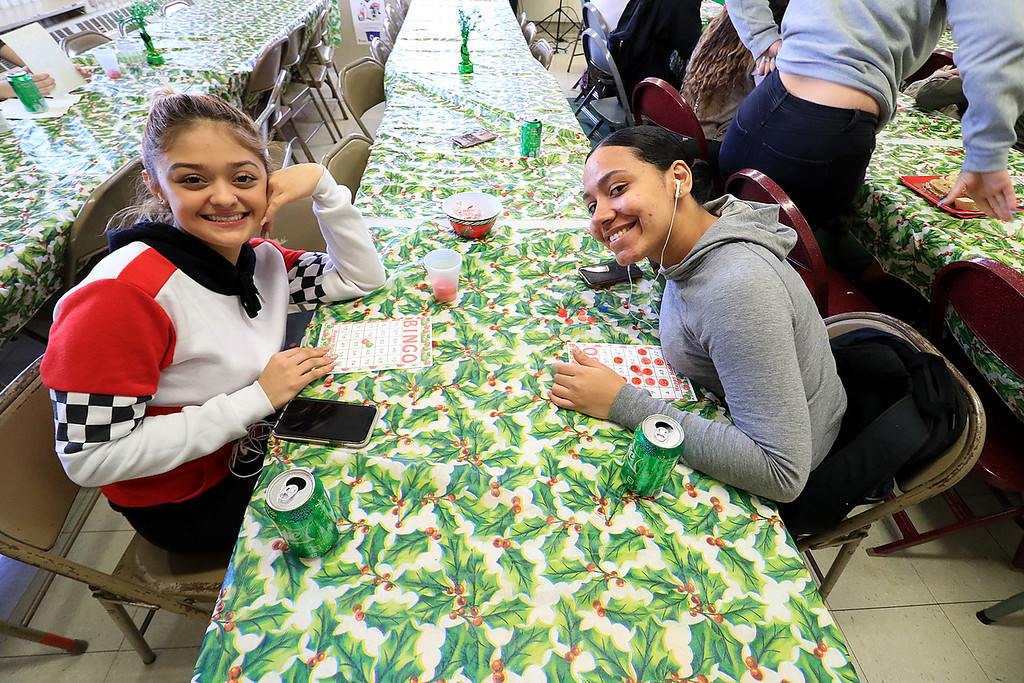 . Goodrich Academy in Fitchburg held a holiday lunch for students on Wednesday afternoon, December 19, 2018. They had six sponsors that helped them so they could put on this event for the students. They were Brandon Funeral Home, Ilforno Restaurant, A&B Tires, Foster Insurance, HML Development and Leo Xarras. Enjoying playing som bing after they had lunch was, from left, Noelia Velasquez, 17, and Jeneliz Betancourt, 18. SENTINEL & ENTERPRISE/JOHN LOVE