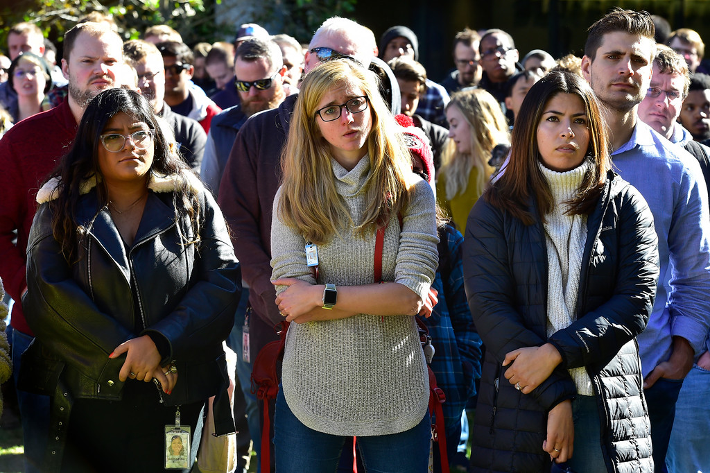 ". BOULDER, CO - NOVEMBER 1, 2018 Google employees Sam Moreno, left, Katie Slavin, Keny Cuellar listen to speakers during the Boulder Colorado Google Campus ""Walkout For Real Change\"" on Thursday November 1, 2018. Employees walked out from their jobs to protest and as for change the sexual harassment policies at Google.  (Photo by Paul Aiken/Staff Photographer)"