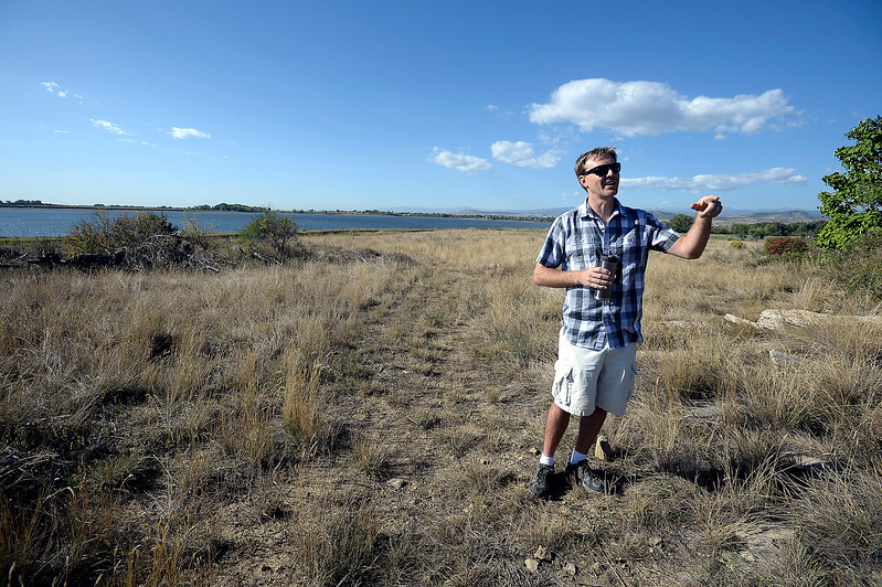 Jeromy Ginther shows the area behind his house Wednesday, Sept. 20, 2017, where Google Maps directs people to the north shore of Lonetree Reservoir southwest of Loveland. The problem is that Google Maps are wrong. It is not a public access to the lake, it's private property. Ginther says that in the summertime people looking for access to the lake with their boat trailers have even been stuck in his driveway trying to turn around.  (Photo by Jenny Sparks/Loveland Reporter-Herad)