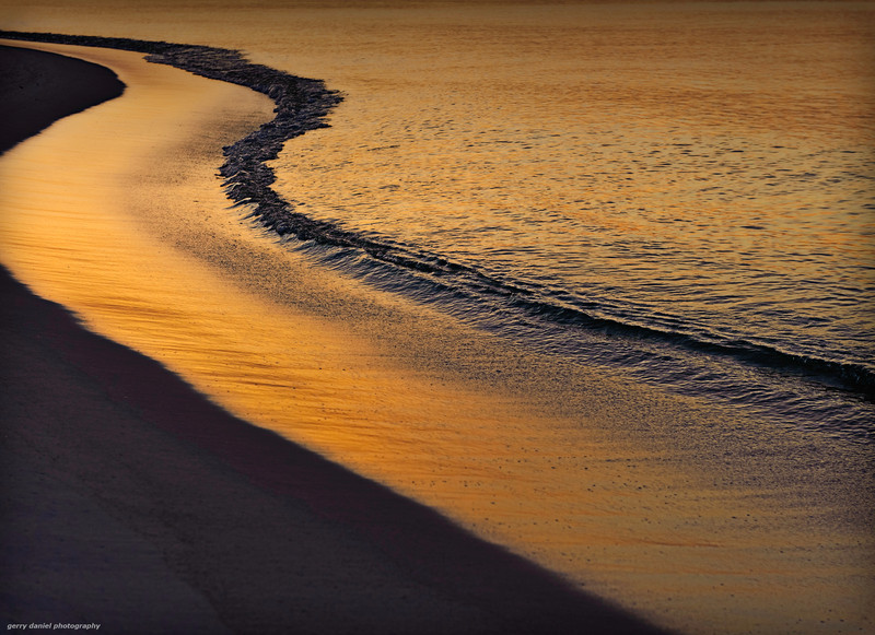 sunrise at the edge of the water, Navarre Beach, Florida