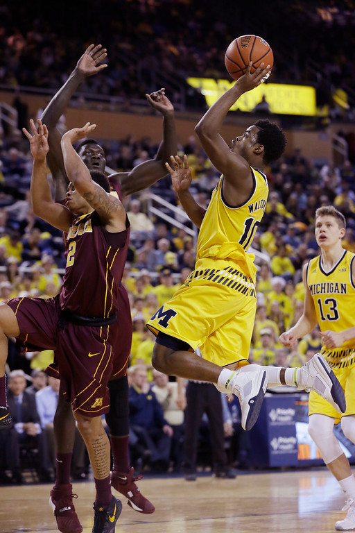 . Michigan guard Derrick Walton Jr. (10) makes a layup during the second half of an NCAA college basketball game against Minnesota, Wednesday, Jan. 20, 2016 in Ann Arbor, Mich. (AP Photo/Carlos Osorio)