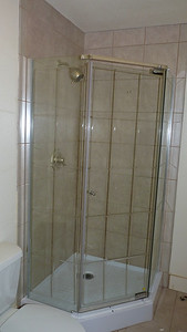 Glass and ceramic tile shower enclosure.