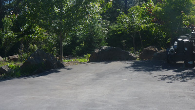 Secluded paved parking area reserved for guests.