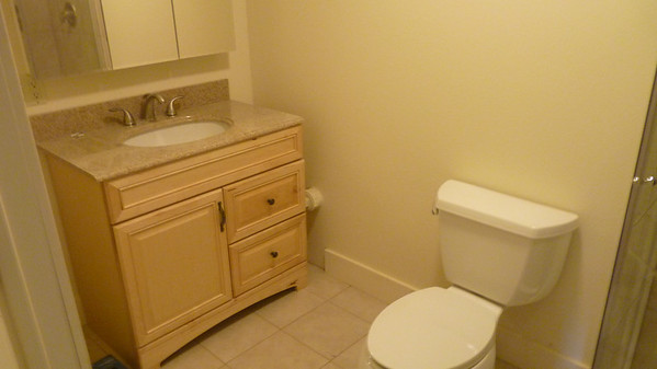 Ceramic tile floors and granite counter tops in the bathroom. The floors have  radiant heating.