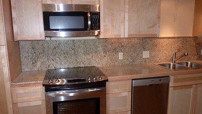 Close up of the granite counter, range, microwave and dishwasher.  Full kitchen with toaster, coffee maker, blender, ice maker, cooking utensils and quality pots and pans.
