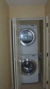 New full size front loading washing machine and dryer.