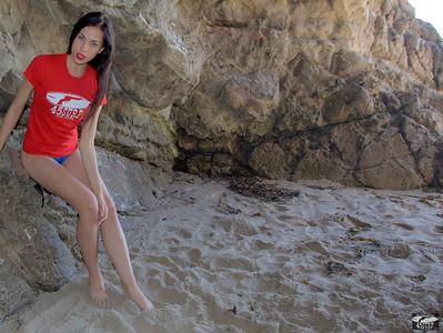 Pretty Brunette Swimsuit Bikini Model in Sea Cave