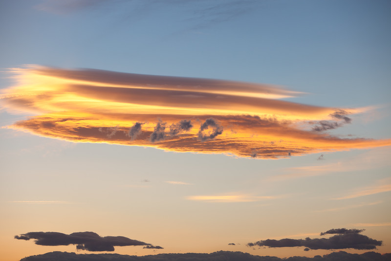 Lenticular Clouds and Rotor at Sunset