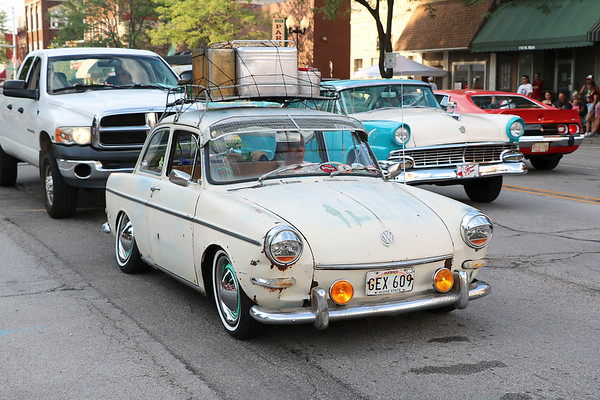 Roger Schneider | The Goshen News<br /> This vintage Volkswagen, featuring a luggage rack, cruised Goshen Friday night.
