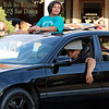 Roger Schneider | The Goshen News<br /> A girl stands in a car and uses the sunroof opening to get a better view of the cars participating in Goshen's Cruisin' Reunion Friday.