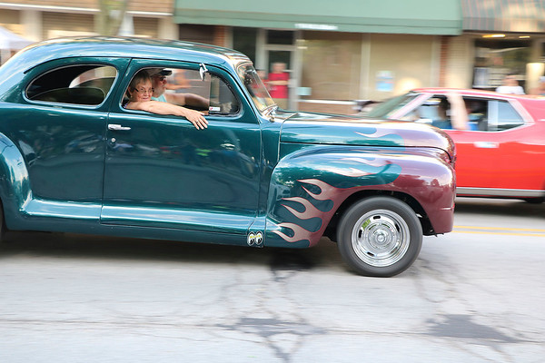 Roger Schneider | The Gosen A couple cruises down Goshen's Main Street Friday night in their vintage car featuring flames on the fendes.