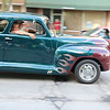 Roger Schneider | The Gosen<br /> A couple cruises down Goshen's Main Street Friday night in their vintage car featuring flames on the fendes.