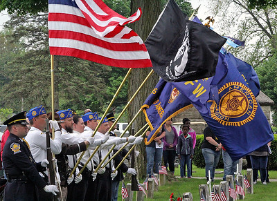 Roger Schneider | The Goshen News Members of the color guard hold a variety of flags at Oakridge Cemetery in Goshen during Memorial Day services.