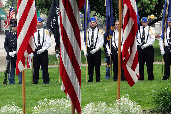 Roger Schneider | The Goshen News The Memorial Day color guard stands at rest behind a row of American flags in preparation for services on the lawn of the Elkhart County Courthouse Monday morning.