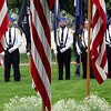 Roger Schneider | The Goshen News<br /> The Memorial Day color guard stands at rest behind a row of American flags in preparation for services on the lawn of the Elkhart County Courthouse Monday morning.