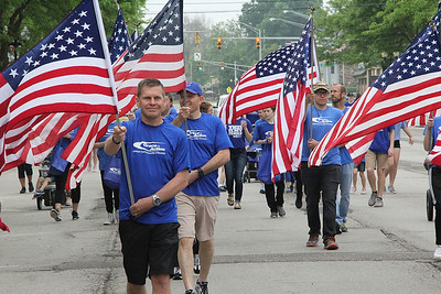 Roger Schneider | The Goshen News Jim Brown of New Paris leads the Grace Community Church's flag group down Main Street in Goshen during the annual Memorial Day parade.