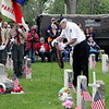 Roger Schneider | The Goshen News  Terry Morgan, Vietnam War veteran, places a wreath in the veterans section of Oakridge Cemetery Monday morning.