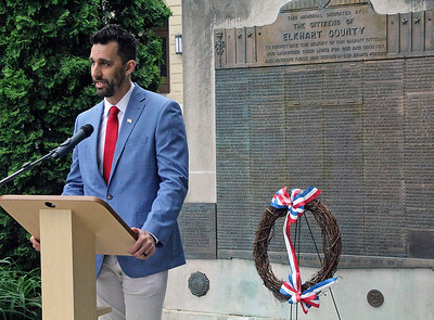 Roger Schneider | The Goshen News With the Elkhart County war memorial behind him, Goshen Mayor Jeremy Stutsman speaks about the sacrifices made by American service members.
