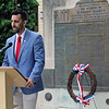 Roger Schneider | The Goshen News<br /> With the Elkhart County war memorial behind him, Goshen Mayor Jeremy Stutsman speaks about the sacrifices made by American service members.