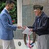 Roger Schneider | The Goshen News<br /> Goshen Mayor Jeremy Stutsman, left, presents John Alheim, with a key to the city during Memorial Day services Monday morning. Alheim is the city's former fire chief and serves as commander of the Goshen Veterans of Foreign Wars post. Stutsman made the presentation, saying Alheim has served others most of his life.